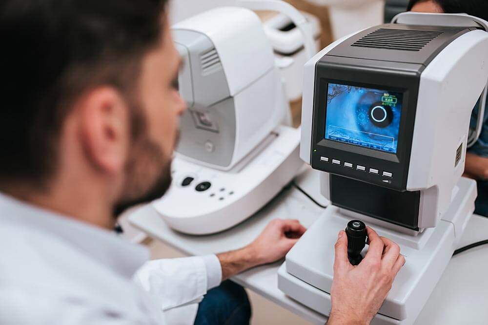 Doctor working with a high-tech optometry machine