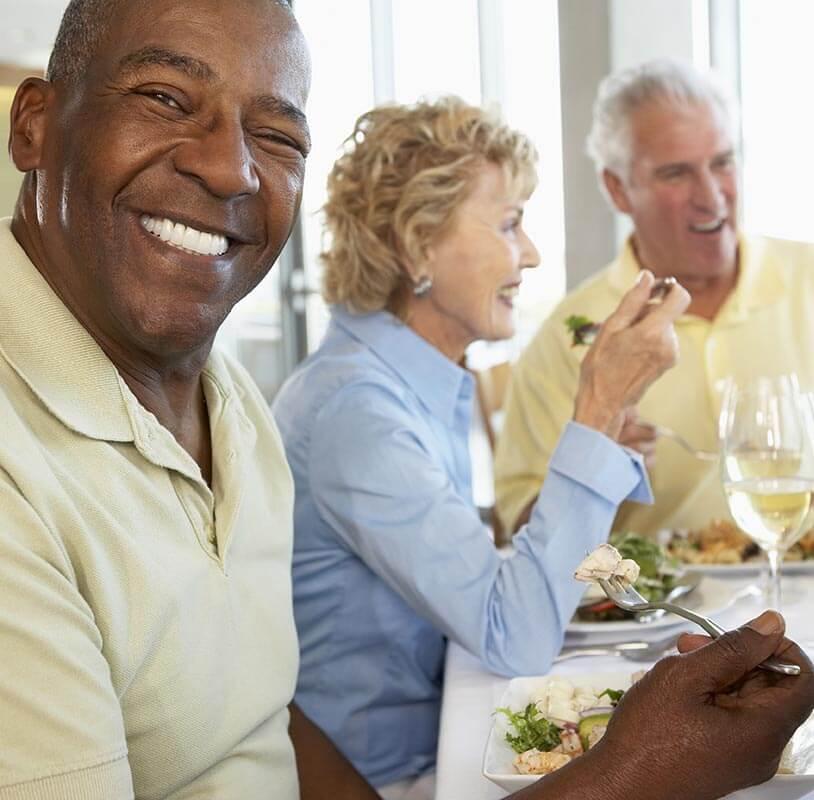 Older people enjoying a meal together